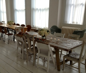 Rustic tables and unmatched chairs made up just part of the NYC Shabby Chic look of Gary's Loft.