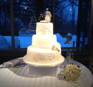 I love this early shot of the white cake with the white snow behind. Just had to show how beautiful a winter wedding can be!