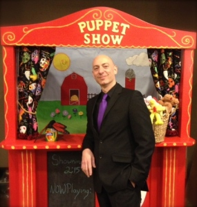Puppet Show and Yves! Yves poses with one of the auction items.