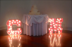 These awesome vintage-style marquee letters framed the cake table.