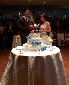 Bianca and Lyncean enjoying their beautiful and origami themed wedding cake.